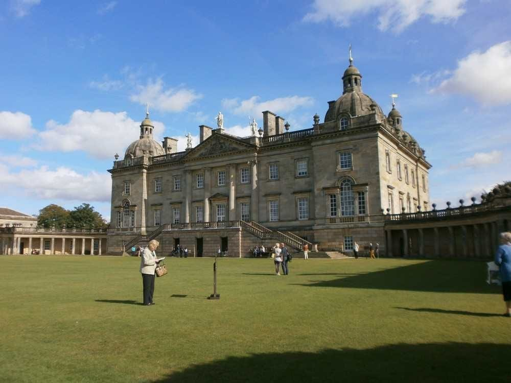 Houghton Hall in Norfolk is grander than Melton Constable, but gives an idea as built about the same time, though in stone. Melton Constable is built in mellow brick