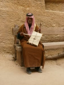 Old man playing Oud at Little Petra